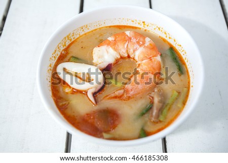 Tom yam kung, Tom yum seafood spicy , thai food on white wood backgrounds