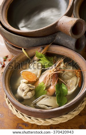 Tom Yam Ruam Pak or Clear Tom Yam Soup with Chicken and Prawns. Non sharpen