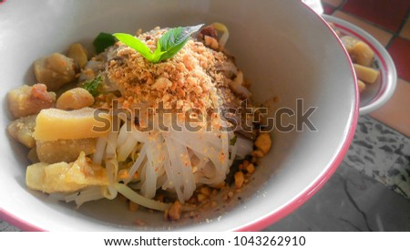 Tom yum dry noodles no soup and Pork meatballs Recommended top dishes menu in Thailand . spicy thai food
