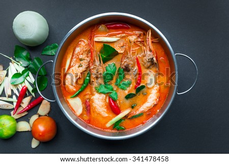 Tom Yum Goong,Thai Food, Top view on black background - stock photo