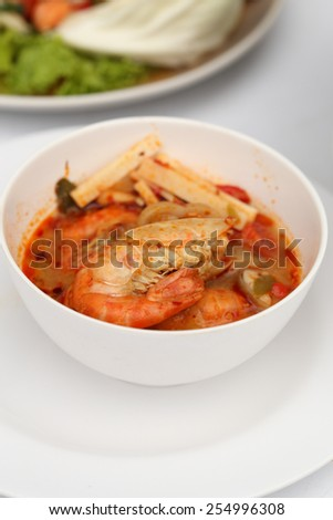 Tom Yum Goong - Thai hot and spicy soup with shrimp - Thai Cuisine - stock photo