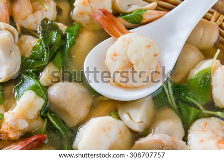 Tom Yum Kung or spicy soup with shrimp, thai cuisine.