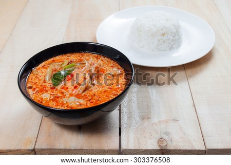 Tom Yum soup with Jasmine Rice on wooden table,thai food