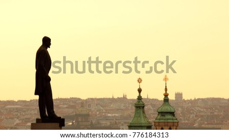 Tomas Garrigue Masaryk statue silhouette looking down on the city. Monument of the first President of Czechoslovakia stands on the square close to the Prague castle, Czech Republic.
