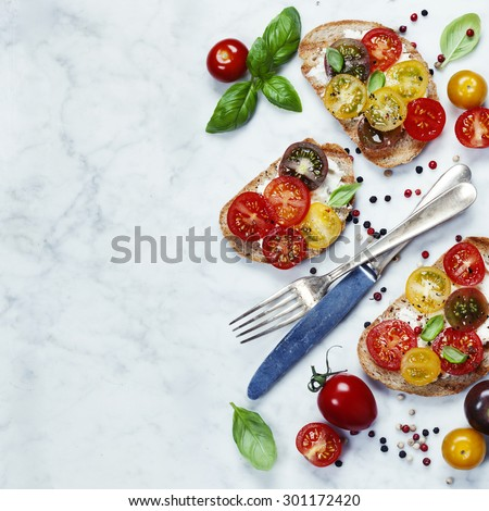 Tomato and basil sandwiches with ingredients - Italian, Vegetarian or Healthy food concept - stock photo