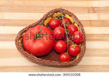 Tomato and cherry tomatoes in a basket.