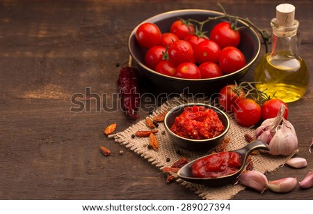 tomato and chilli sauce with ingredients - stock photo