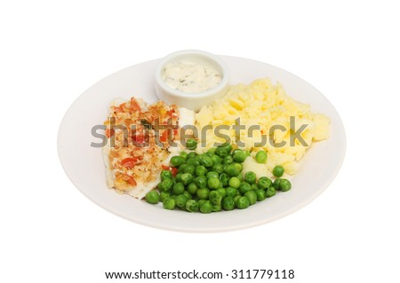 Tomato and herb crusted fish fillet on a plate with peas, mashed potatoes and tartar sauce isolated against white - stock photo