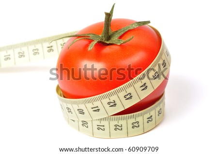 Tomato and measuring tape isolated on white