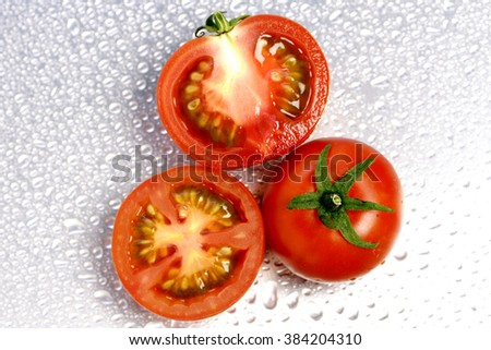 Tomato and slices isolated on white - stock photo