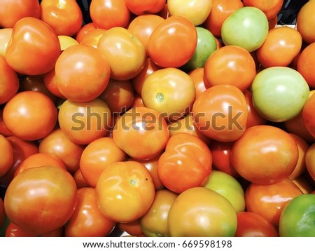 Tomato background / Tomatoes are a treasure of riches when it comes to their antioxidant benefits.