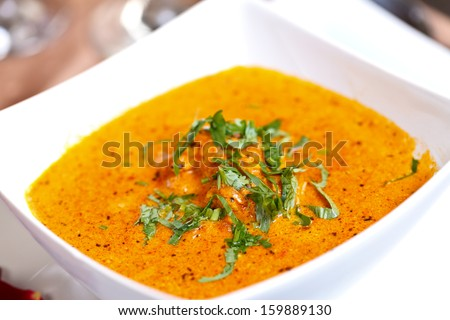 Tomato based curry with fresh cream and dry herbs  - stock photo