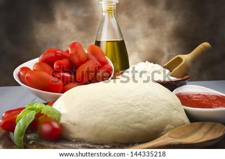 tomato basil flour olive oil for homemade pizza 1 - stock photo