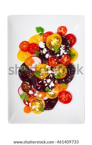 Tomato Beet Salad Isolated on white. Selective focus.