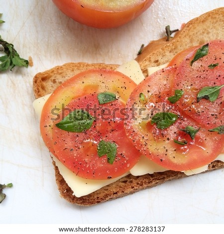 Tomato, cheese and basil on bread