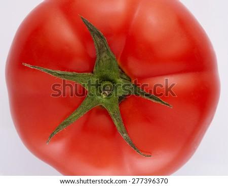 Tomato Close Up Macro View. Fresh Vegetable Texture isolated on White Background - stock photo