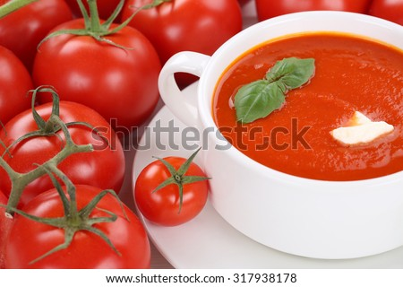 Tomato cream soup meal with fresh tomatoes in bowl - stock photo