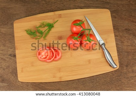 tomato dill with herbs for the preservation on old wooden table. - stock photo