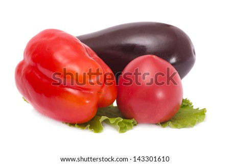 Tomato eggplant and pepper isolated on white - stock photo