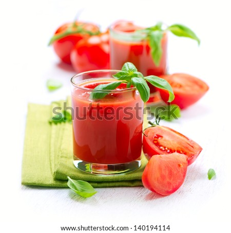 Tomato Juice and Fresh Tomatoes isolated on a White Background - stock photo