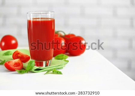 Tomato juice and fresh tomatoes on wooden table close-up - stock photo