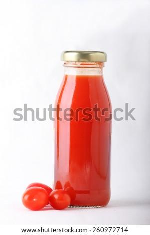 tomato juice bottle with fresh tomato , isolated on white background - stock photo