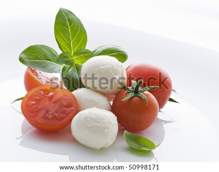 Tomato, mozzarella and fresh basil close up shoot - stock photo