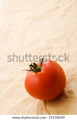 Tomato on grunge paper background.
