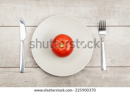 Tomato on Plate with wood Background  - stock photo