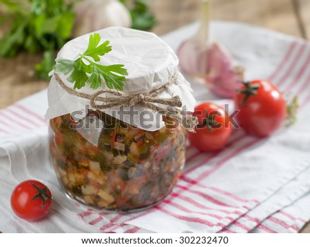Tomato, pepper, celery and zucchini preserves in glass jar, selective focus  - stock photo