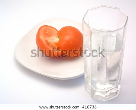 tomato, plate and glass of water