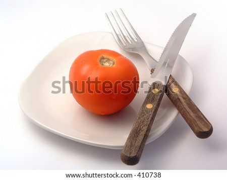 tomato, plate, fork and knife