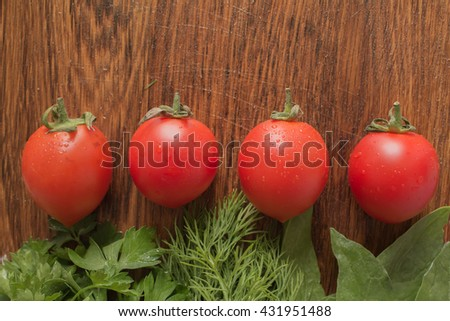 tomato quartet on the cutting board