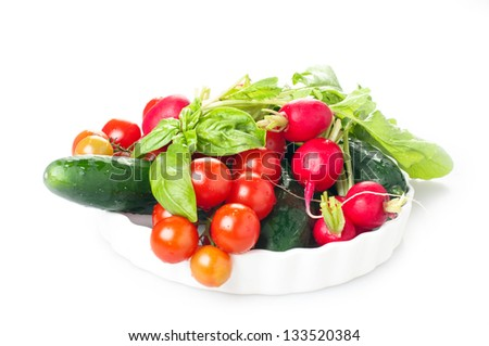 Tomato, radish, cucmber and basil in white background
