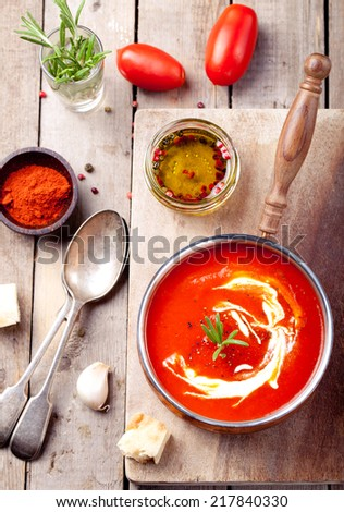 Tomato, red pepper soup, sauce with olive oil, rosemary and smoked paprika on a wooden background. . - stock photo