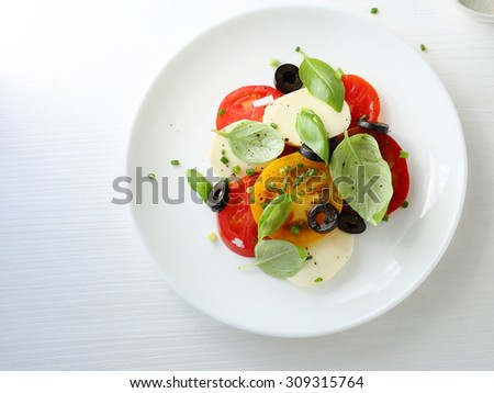 tomato salad on plate, food top view - stock photo