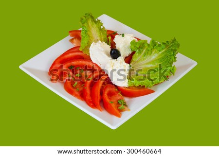 Tomato salad with cottage cheese. Isolated with a clipping path.