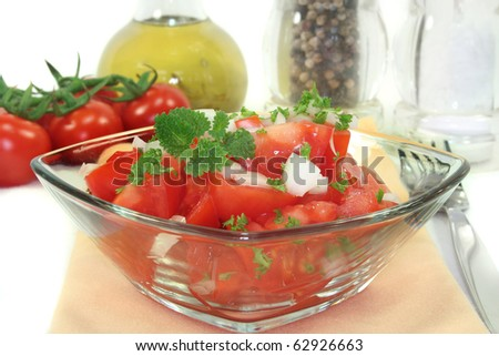 Tomato salad with fresh herbs and onions