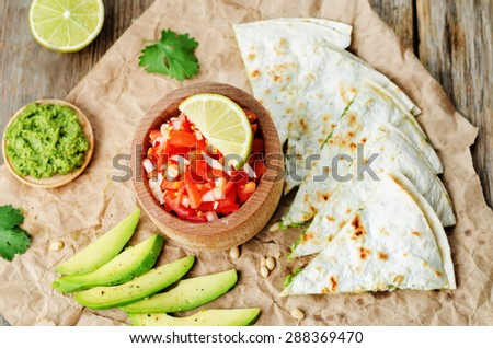 tomato salsa, Pico de Gallo, with cilantro pesto quesadilla. the toning. selective focus - stock photo