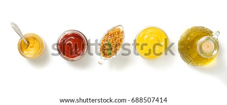 tomato sauce and mustard in bowl isolated on white background