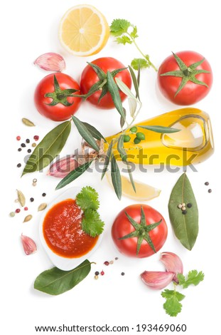 Tomato  sauce and the ingredients ( olive oil, spices,  lemon, tomato), isolated on white, top view - stock photo