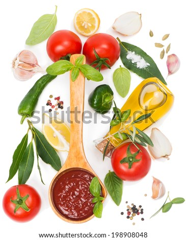 tomato sauce in a wooden spoon and fresh ingredients  on a white,  from top view - stock photo