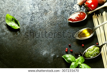 Tomato sauce, olive oil, pesto and pasta - Traditional Italian cooking - stock photo