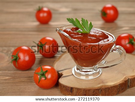 Tomato sauce on a brown background - stock photo
