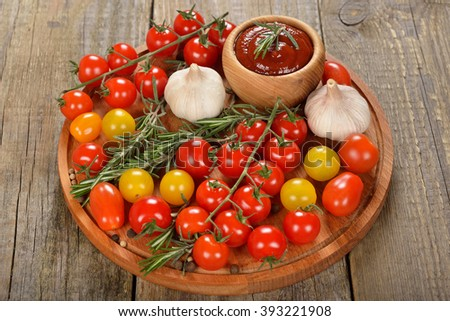 Tomato sauce with spices on a wooden background - stock photo