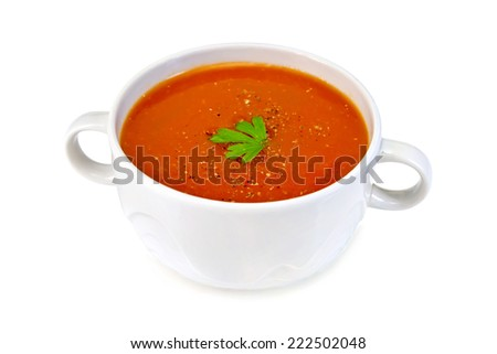 Tomato soup in a white bowl with parsley isolated on white background - stock photo