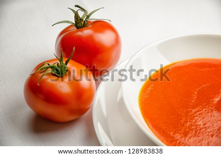 Tomato soup in a white plate - stock photo