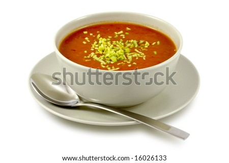 Tomato soup in ceramic bowl on white - stock photo