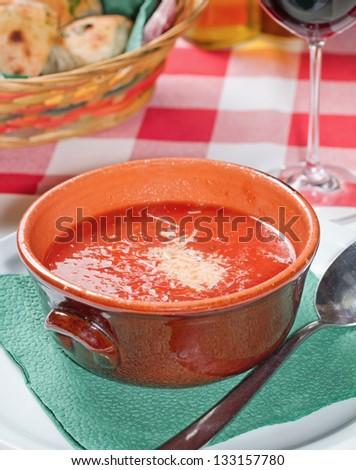 Tomato soup is a soup made with tomatoes as the primary ingredient. It may be served hot or cold, and can be made in many styles - stock photo