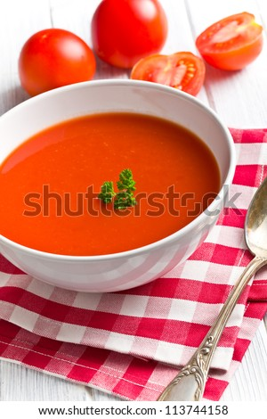 tomato soup on kitchen table - stock photo